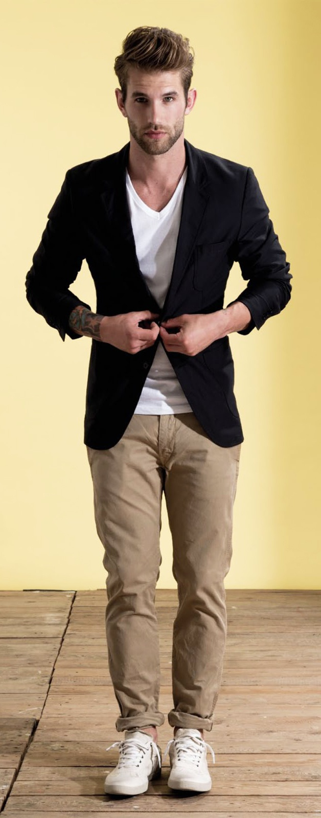 Chinos worn with simple white tee and black blazer.