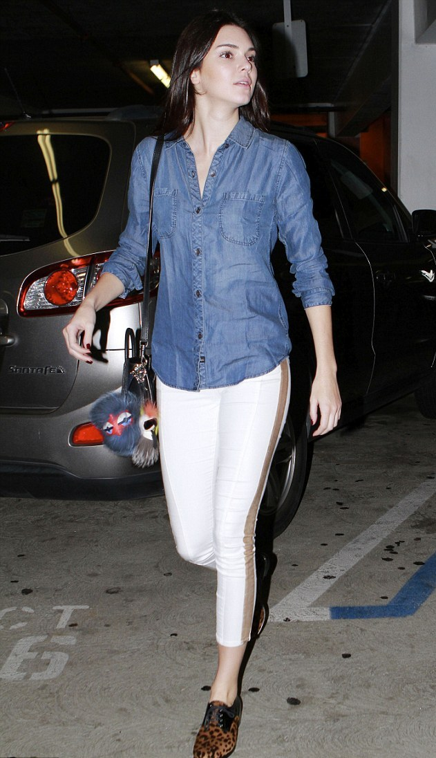 Kendall Jenner cuts casual figure in denim shirt fashion