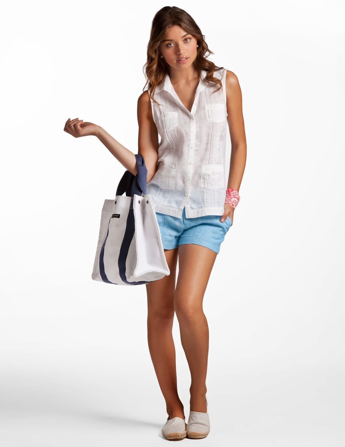 white sleeveless top with blue short and handbag