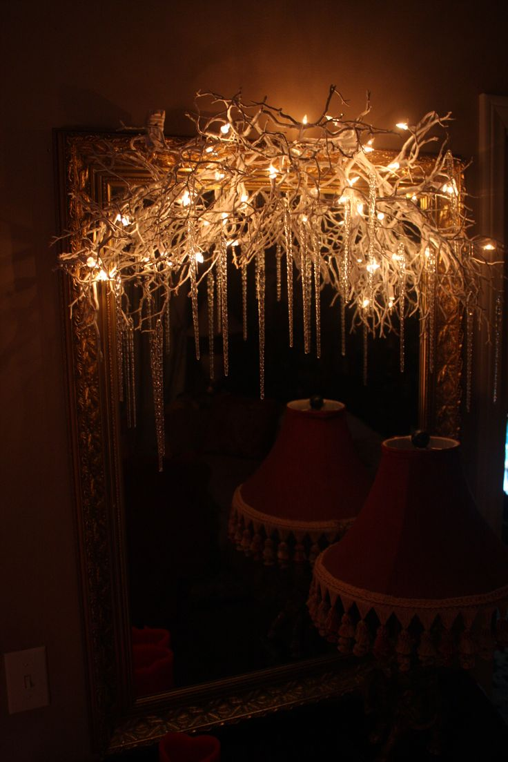 Branches with White Lights and Icicles...Christmas swag over a mirror!