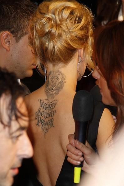 2088-mena-suvari-lion-script-tattoo_large