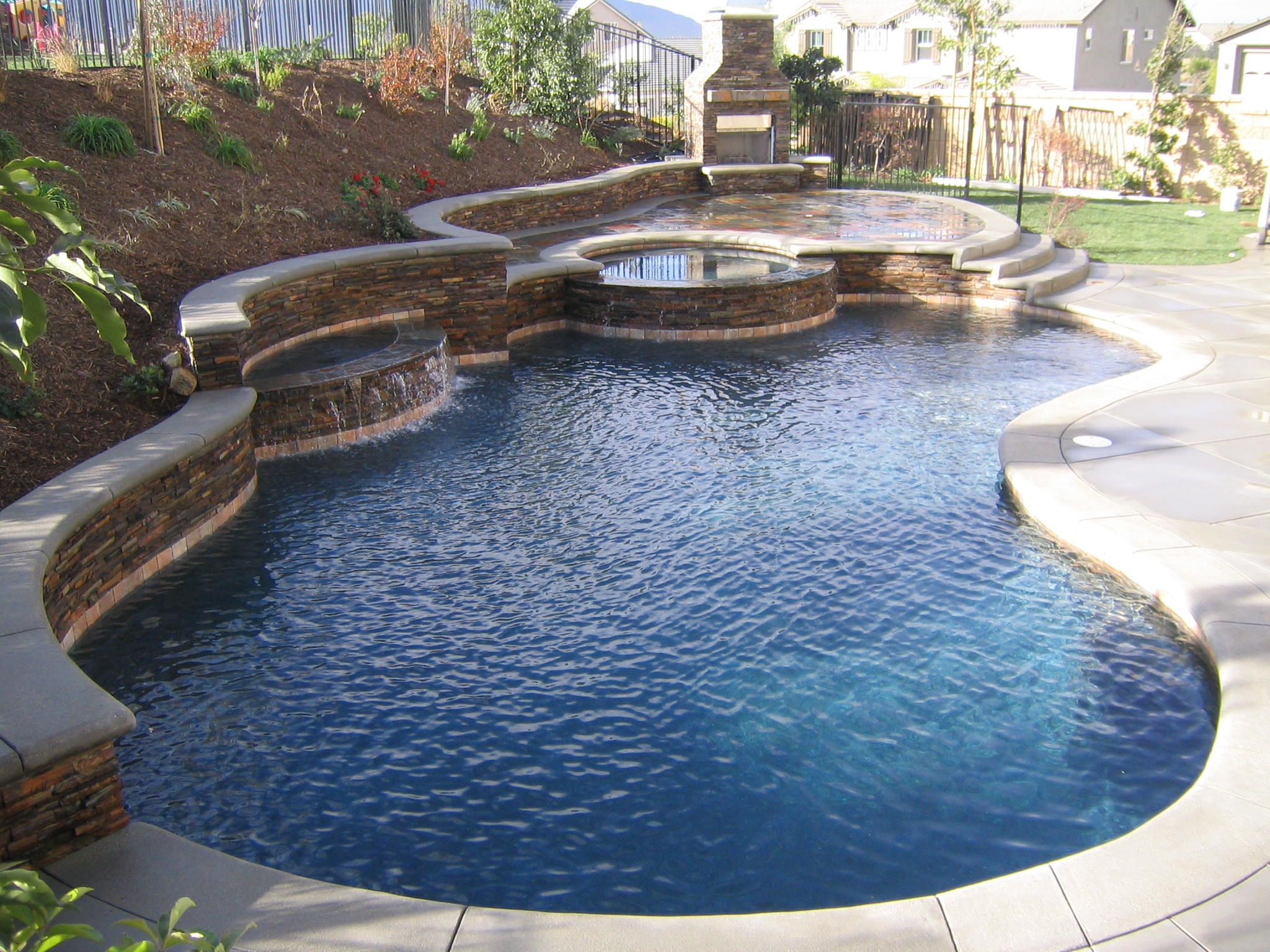 Really-cool-designs-ideas-of-small-backyard-pools-with-simple-garden-and-light-brown-ceramic-with-stone-tile-floor-with-rustic-fireplace-for-outdoor-lounge-space-decor