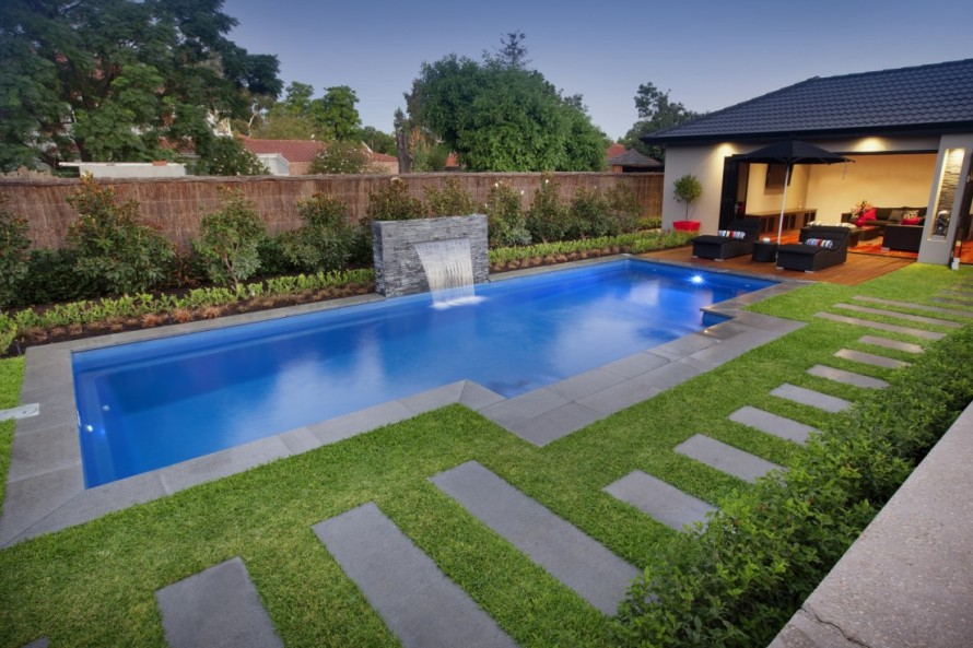swimming-pool-ideas-for-small-backyards-with-splash-water-fall-890x593