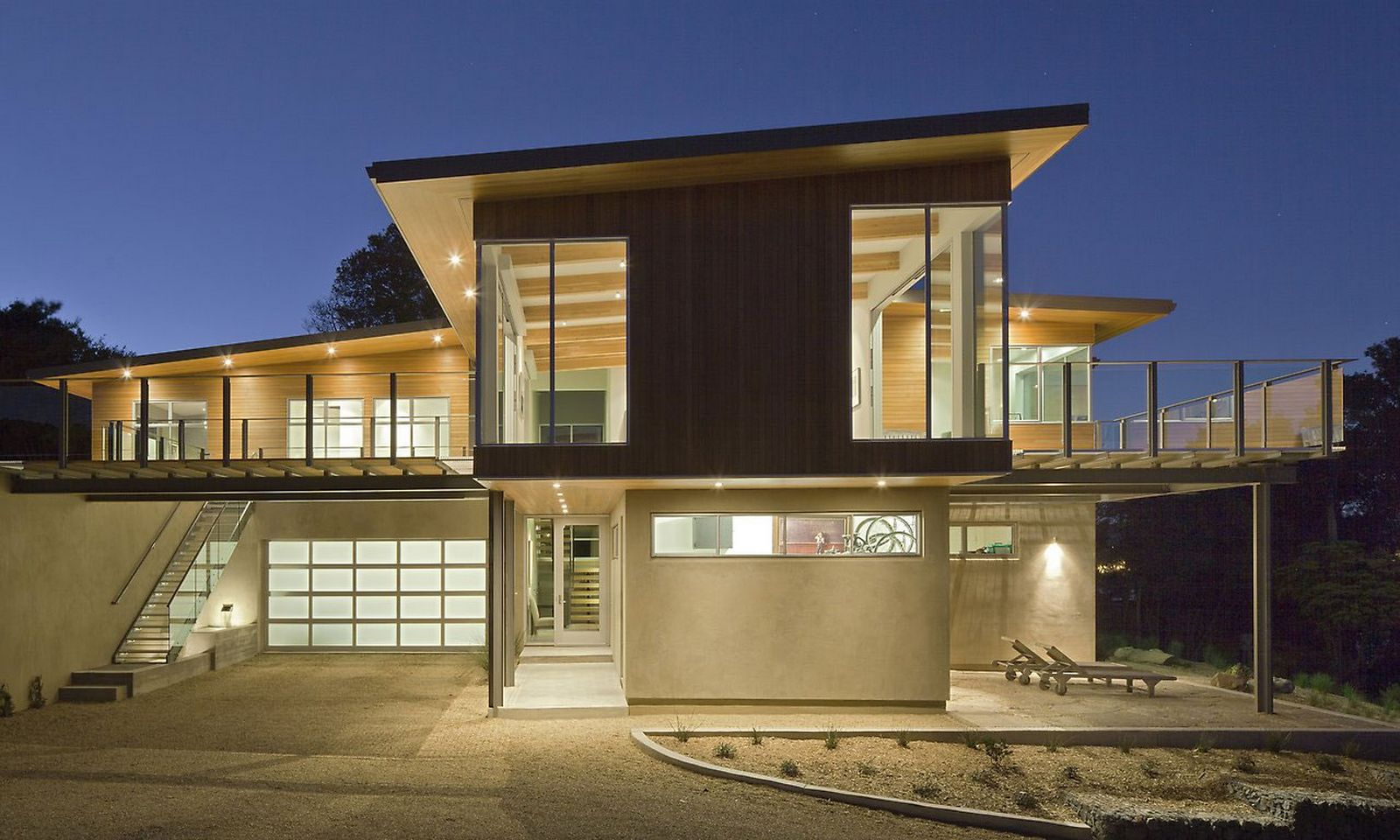 Luxury-Modern-House-Exterior-Design-with-Rest-Area-in-Side-of-The-House-and-with-Beautiful-Interior-White-Lighting