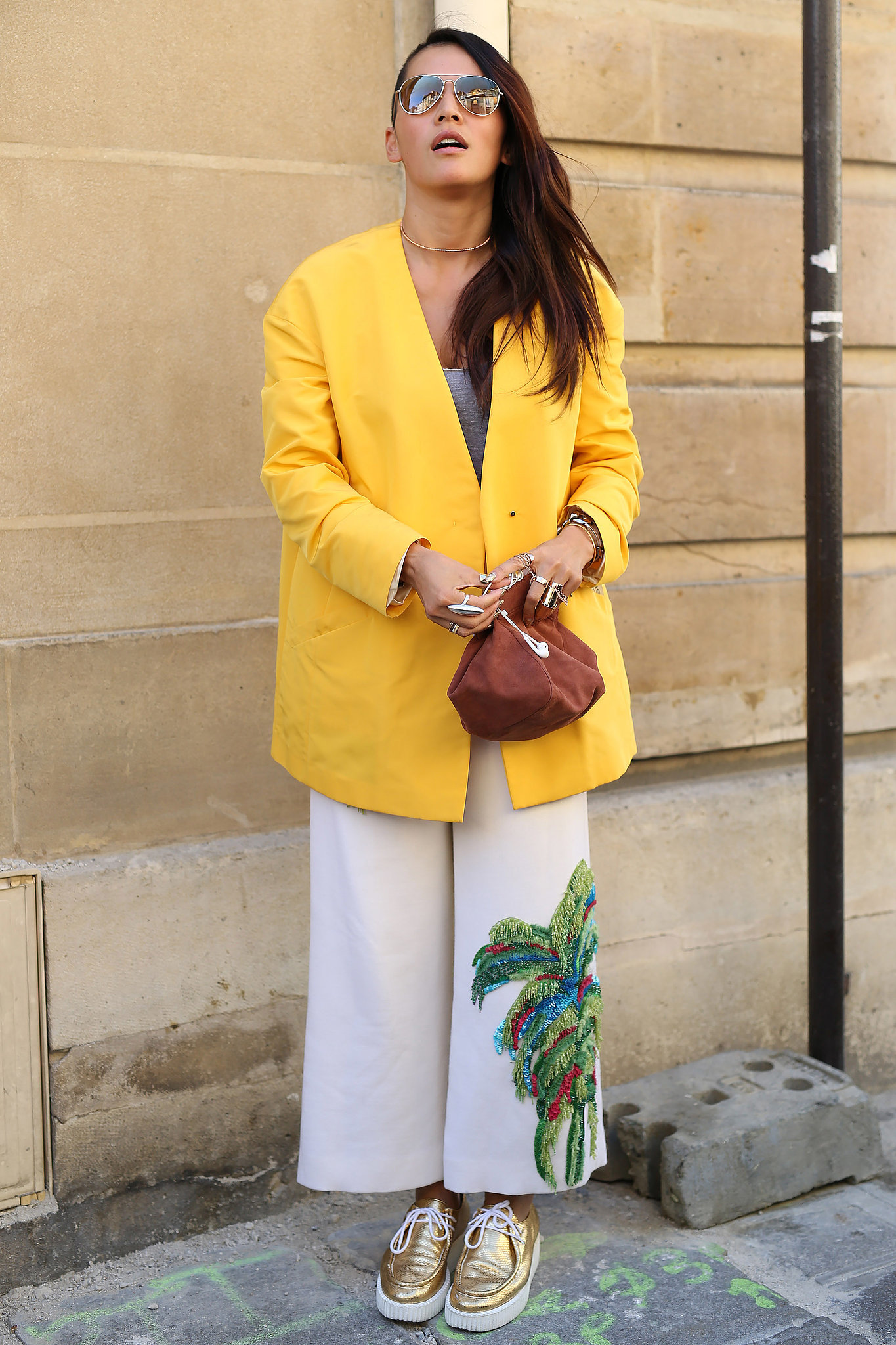 An oversize bright blazer was accented by gold shoes.