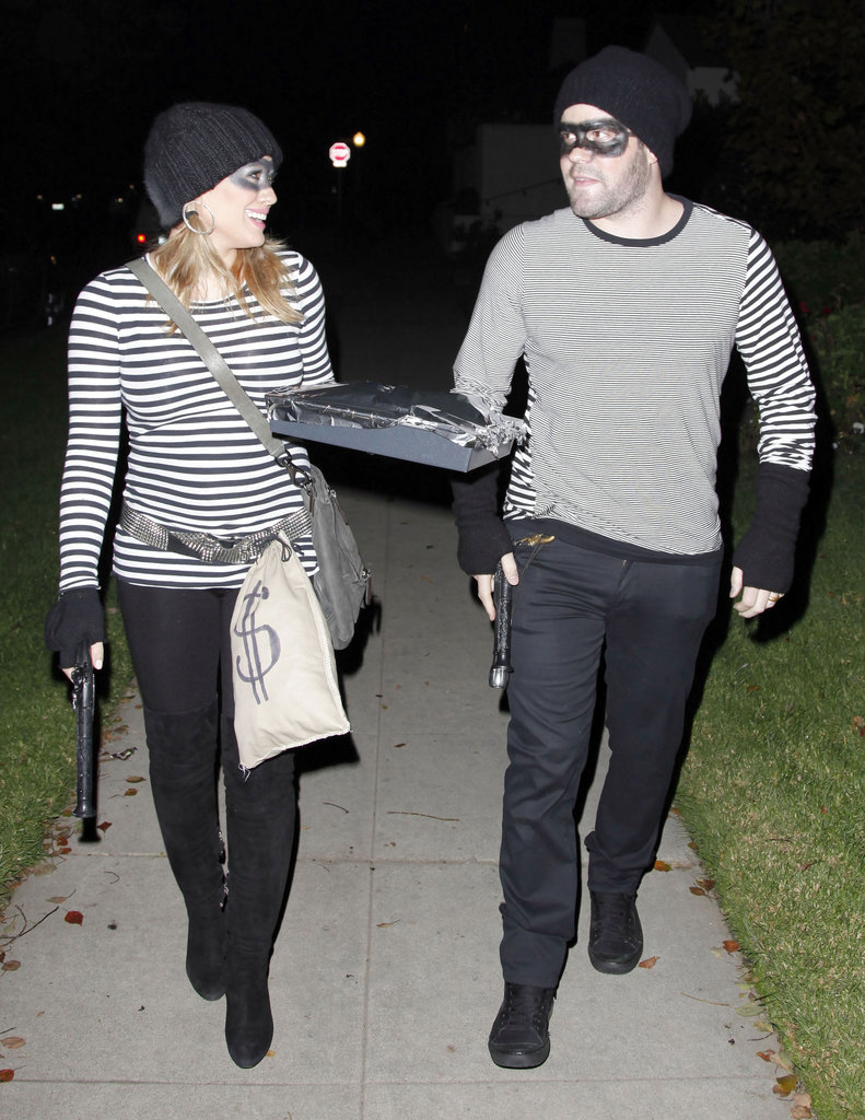 Hilary Duff and Mike Comrie as Burglars