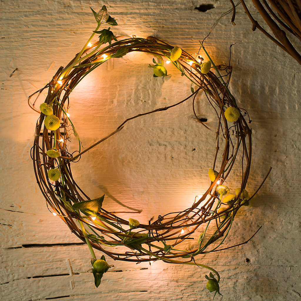 Revive an old wreath by wrapping it in delicate lights.