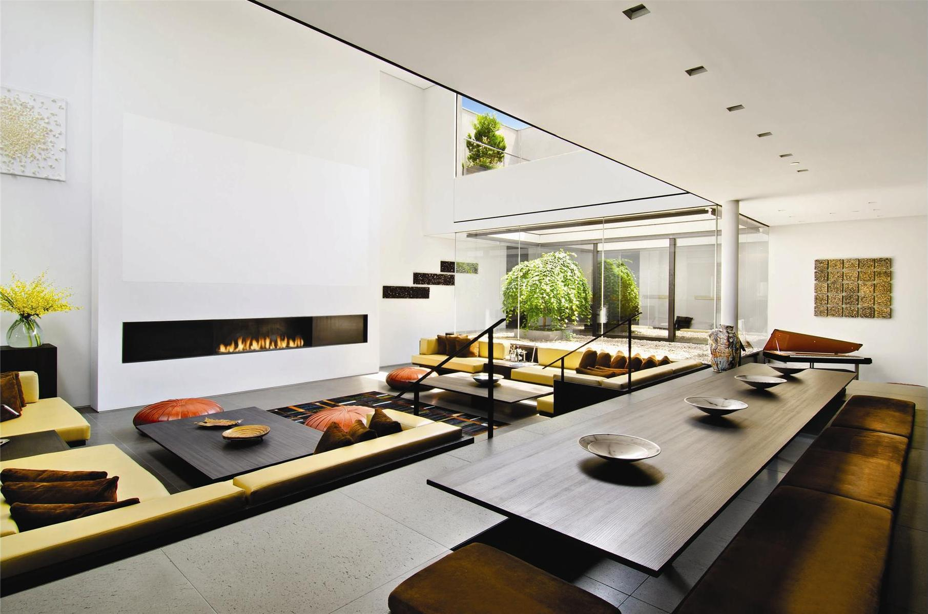 modern-living-room-of-penthouse-design-with-slim-wood-table-and-cool-fireplace-turns-in-white-wall